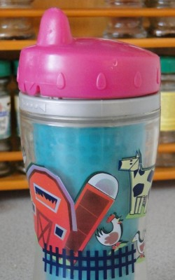 Child's drinking cup showing phallic shaped farm building