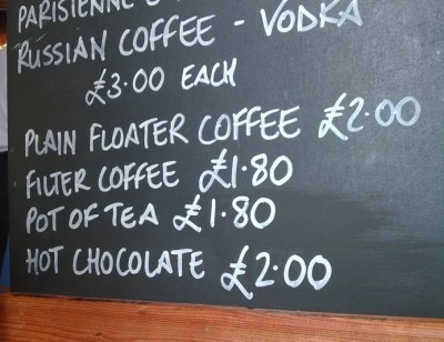 A sign offering floater coffee