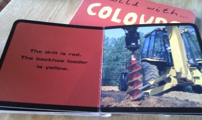 The backhoe loader is yellow