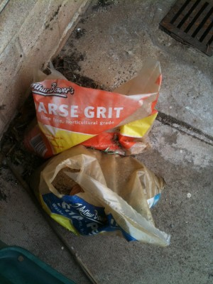 A bag folded so the slogan says Arse Grit