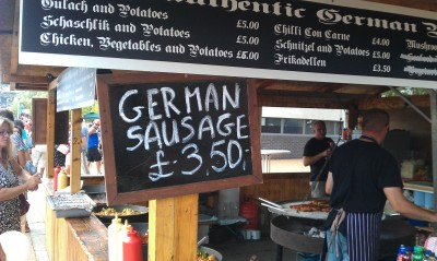 A sign advertising German sausage