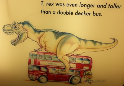 An illustration that looks like T. rex having sex with a bus
