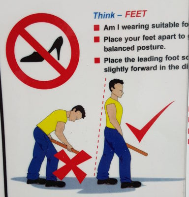 A safety sign saying to place your feet apart and showing a man with what appears to be an erection