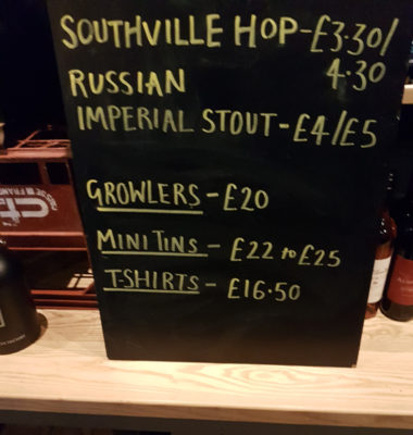 A chalk board in a pub advertising Growlers