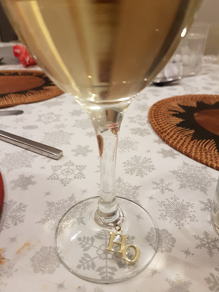 Wine glass with the word Ho on it
