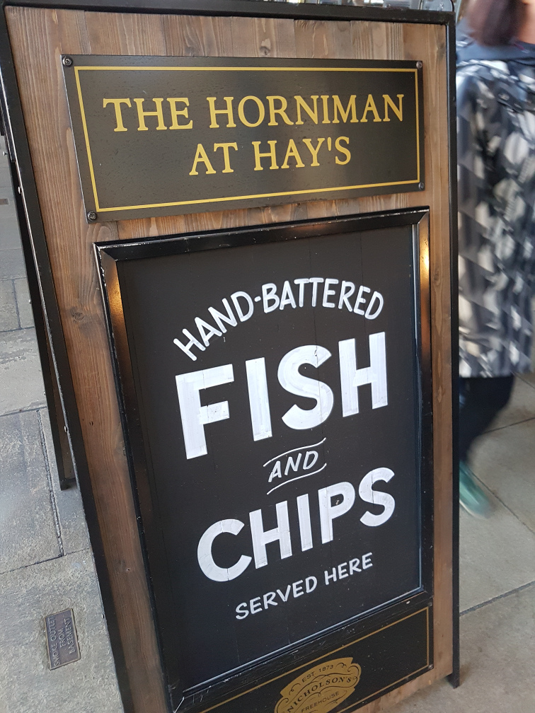 Sign offering hand battered chips at The Horniman